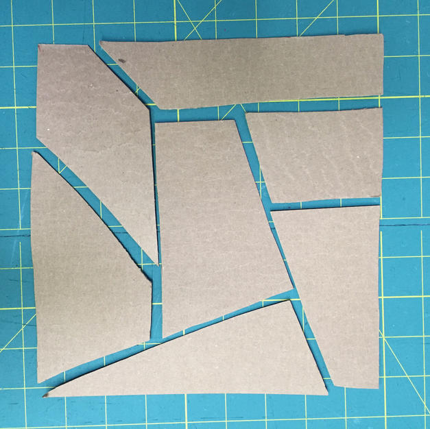 Quilt square template cut from cardstock