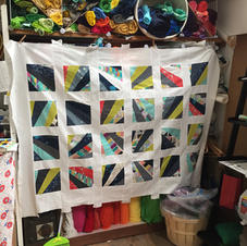 Finished quilt top - all squares are hand sewn!