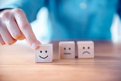 Close up customer hand choose smiley fac