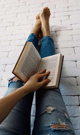 person_in_blue_denim_jeans_reading_book-