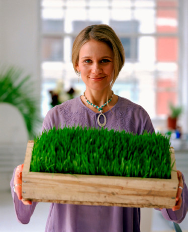 woman growing wheatgrass