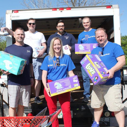 Volunteers help unload donations