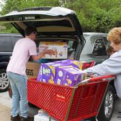 Volunteers help unload donations