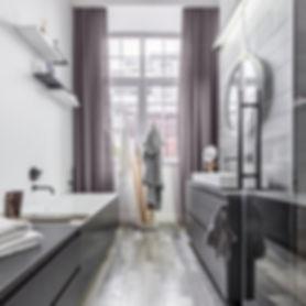 Bright and modern bathroom with custom drapery.
