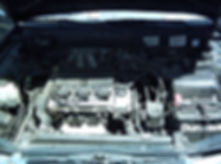Full view of dirty engine compartment