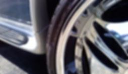 Detail image of chromed rim with low-profile tire