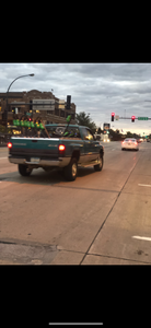 Lime scooters in truck bed driving on a road
