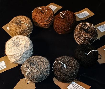 Hand spun undyed alpaca yarn.