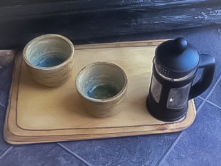 Set of two Stoneware coffee beakers.