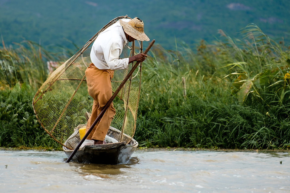 asian-fisherman-with-the-net-on-a-boat-i