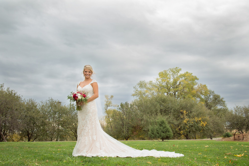 Omaha wedding photographer bride outdoors with bouquet