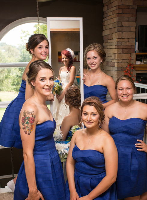Bride in reflection with bridesmaids