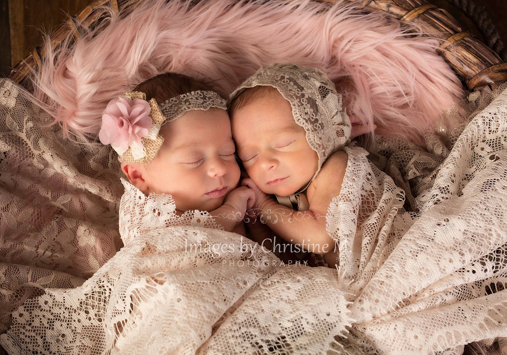 Newborn twin girls wrapped in lace