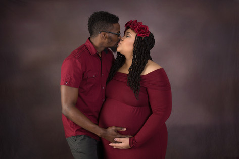 Maternity burgundy couple