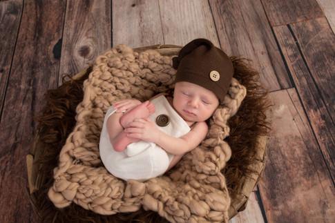 Newborn boy in brown