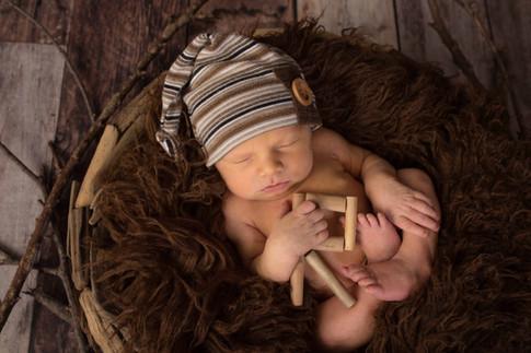 newborn boy with R