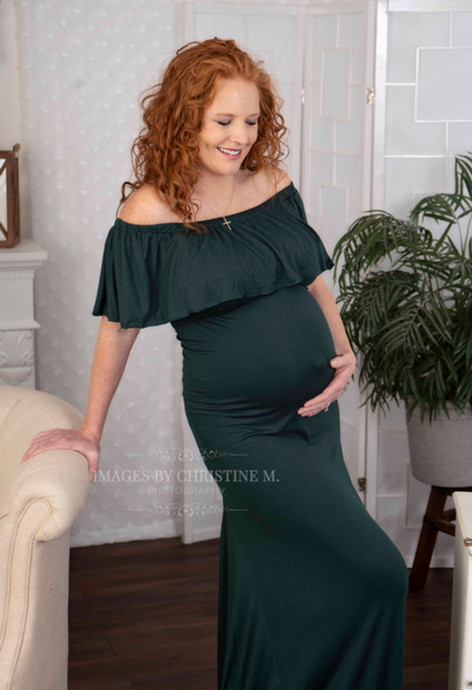 Maternity in green gown