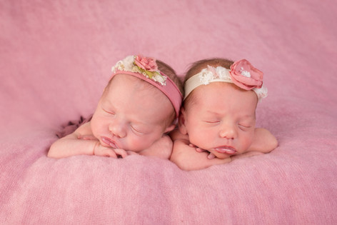 Newborn twins in pink