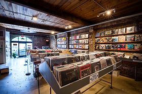 10,000 Hz is a record shop in Opelika, Alabama. Although their brick and mortar is temporarily closed they are still serving customers online and with curbside pickups and free local delivery.