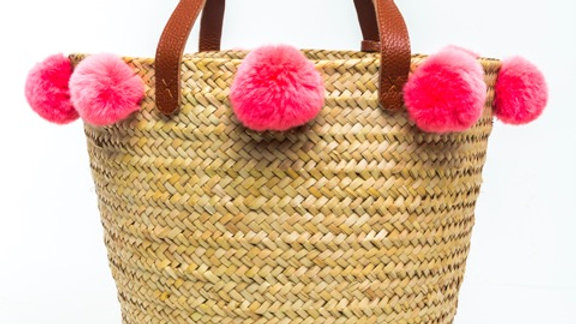 Penrose medium weave straw basket w. leather handles and rabbit fur pompoms
