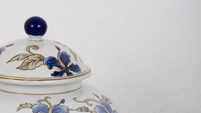 A Set of Two Floral Ceramic Urns