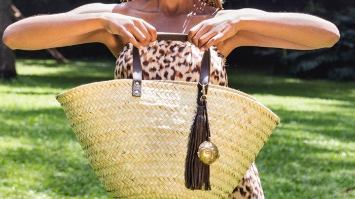 Penrose wide weave straw basket w. leather handles & tassel & brass african mask