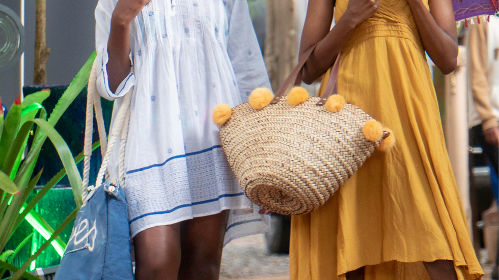 Penrose Tan Washed Woven Basket with Orange Rabbit Pompoms and Leather Handles