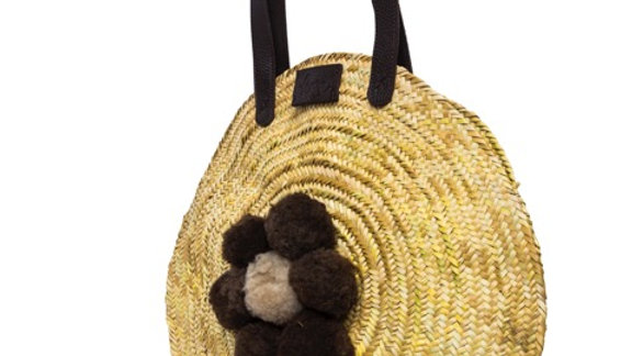 Penrose Circular straw basket - hand cut leather handles and sheepskin pompoms
