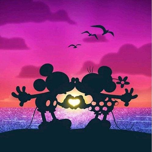 Mickey et  Minnie  au coucher du soleil
