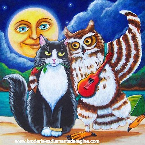 Chat et hibou au clair de lune