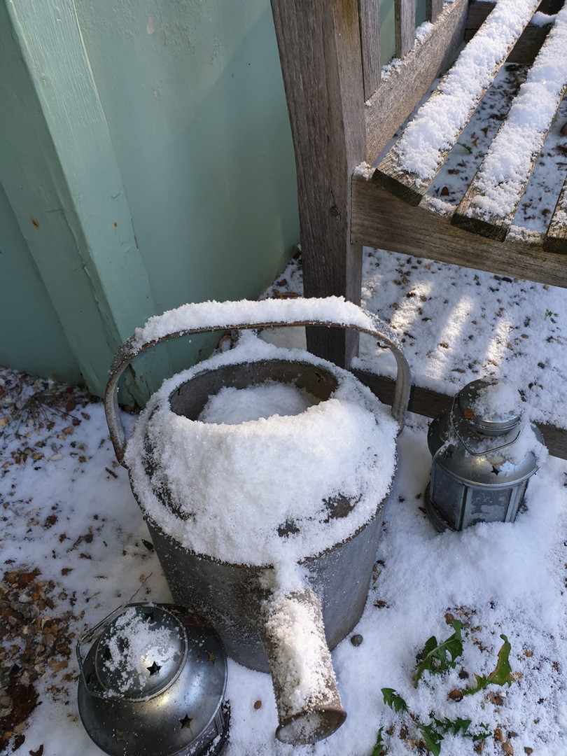 Snow covered watering can using Fake Sno
