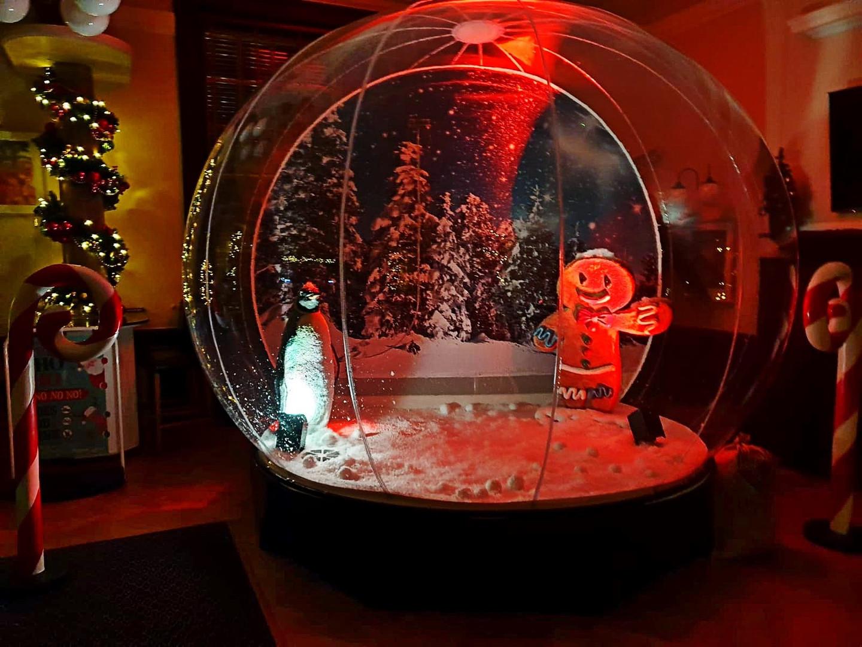 Giant Snow Globe set up Christmas Party