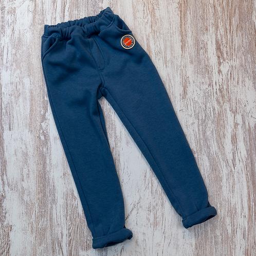 Pantalon avec ceinture élastique et poche à l'arrière