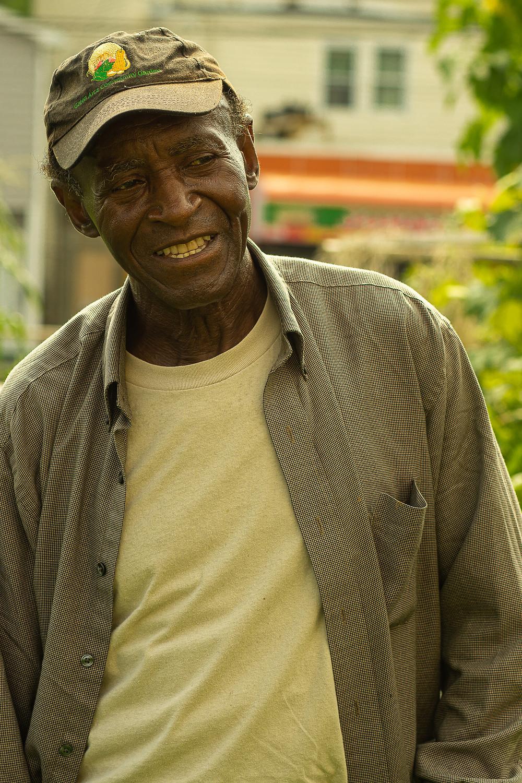 photo of Deacon Davis at Green Acre Community Garden, shot by LacQuan Scott