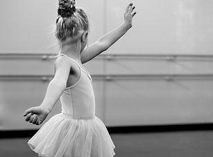 grayscale-photography-of-girl-doing-ball