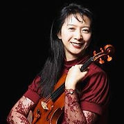Mei Mei Lou, Orchestra Miami Concert Master holding a violin