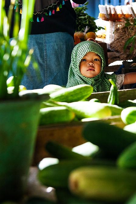 Girl with cucumbers.jpg