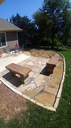 Blonde Patio Stone with Limestone Edging and Cut Rock Benches