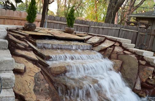 Arkansas Brown Slab Waterfall with Limestone Retaining Wall