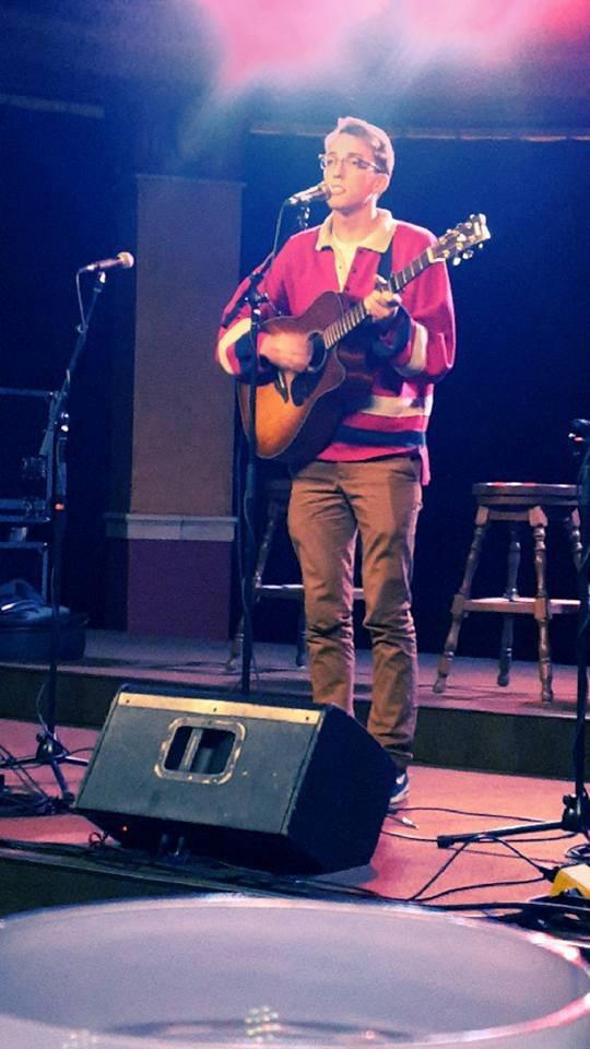 cute guy performing acoustic