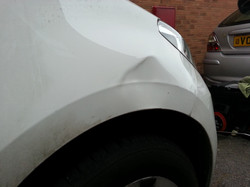 VW Up front wing Dent