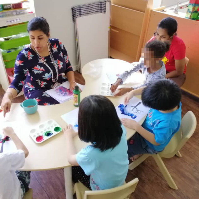 An arts and crafts session is in play and Ashley uses the opportunity to teach social skills such as sharing and taking turns.