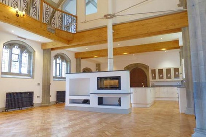 Completed Grade II listed Church conversion with wood burner and new kitchen  in Truro, Cornwall.
