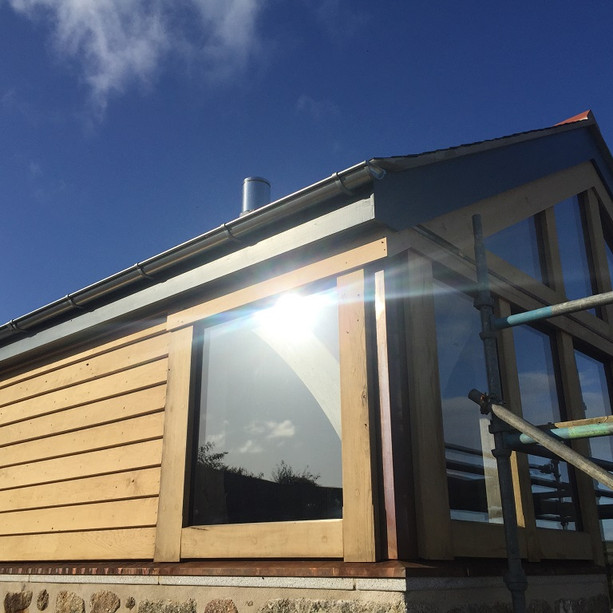 Oak frame and granite barn enjoying the Cornish sunshine (photo courtesy of Oak Frame Cornwall).