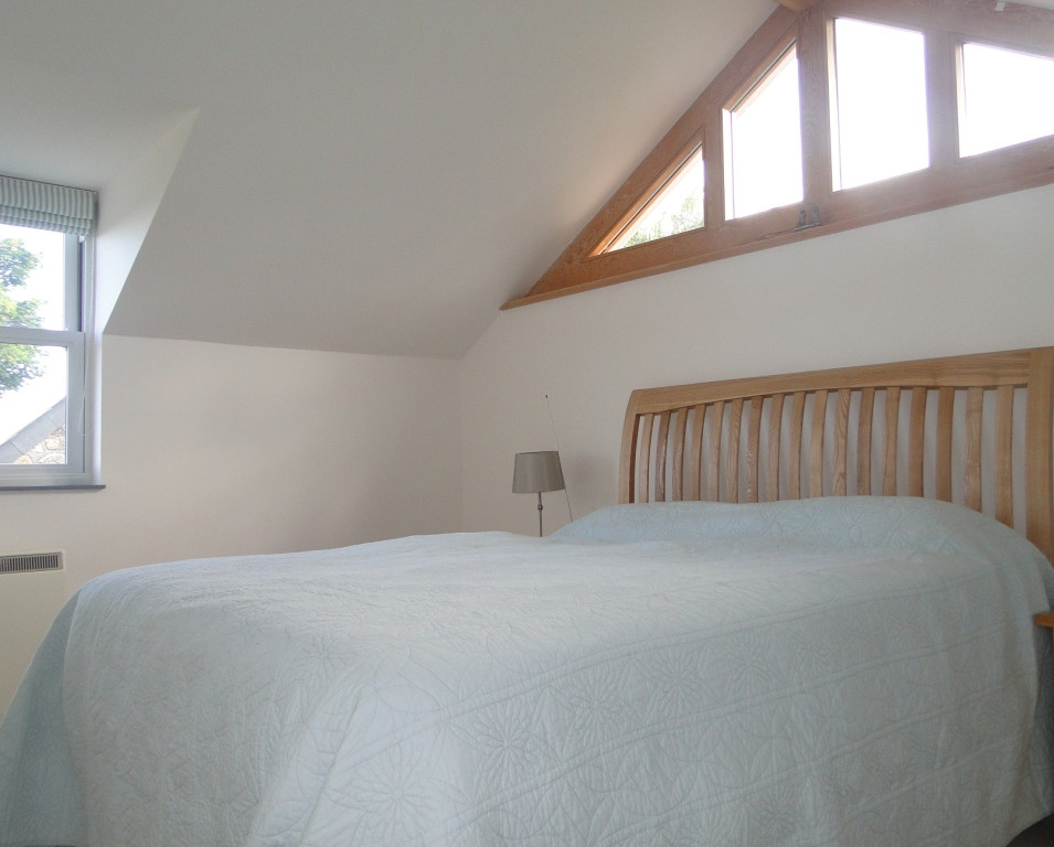 Master bedroom within rear extension to Cornish cottage.