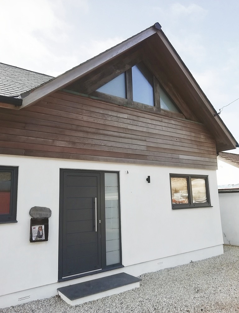 Contemporary beachside home with slate r