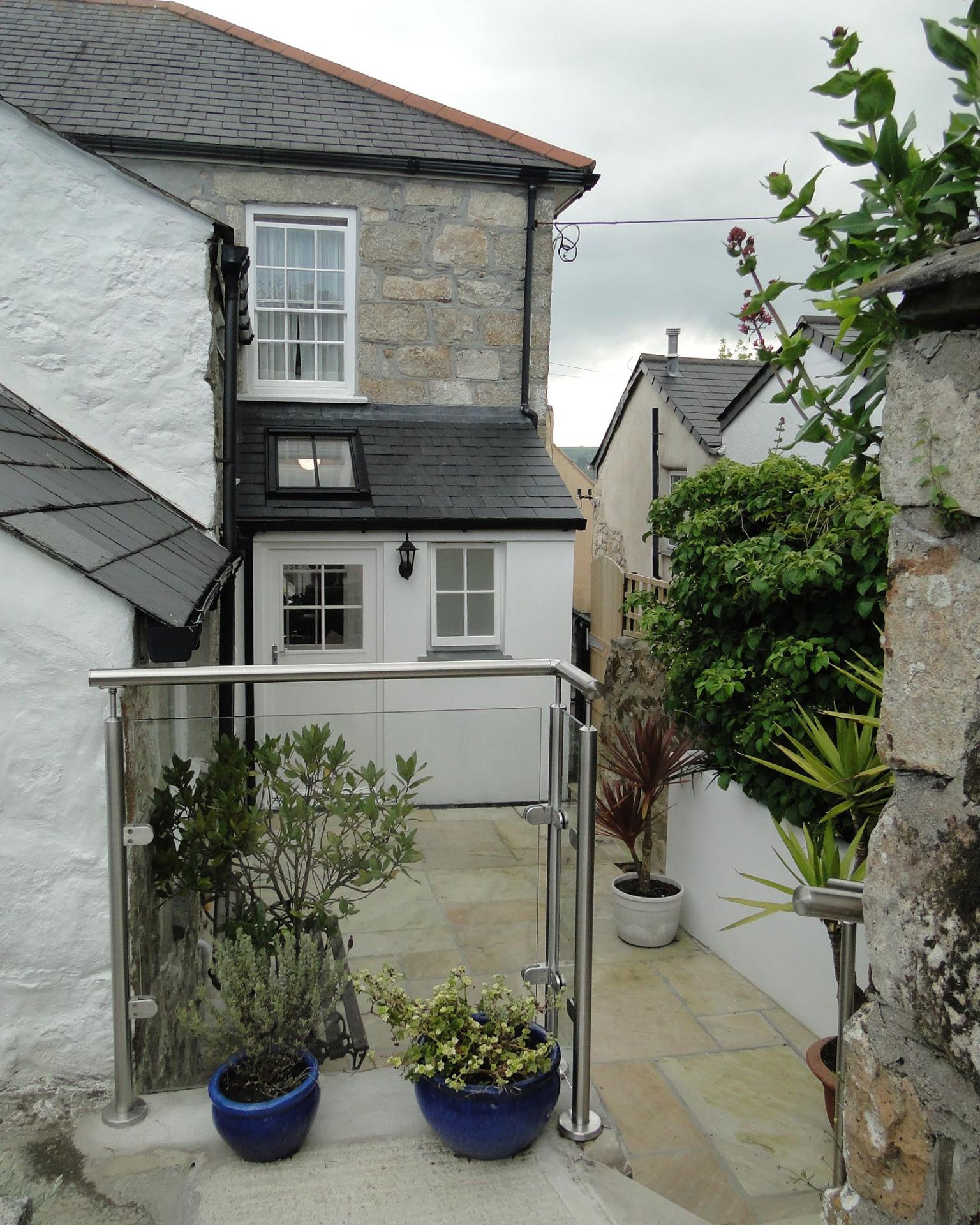 Completed rear extension and patio to Grade II Listed home in St Ives, Cornwall.