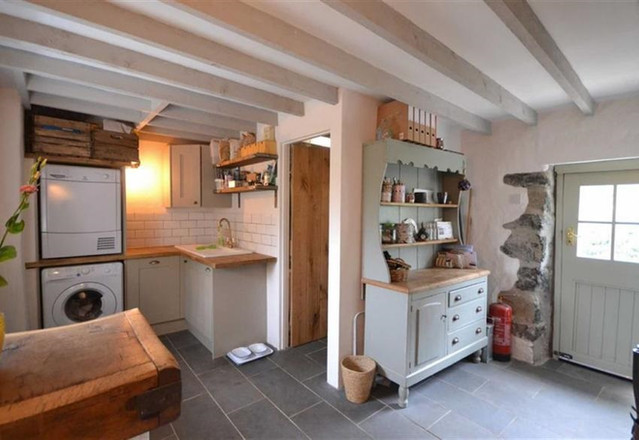 Reconfiguration of rear entrance and Utility of Grade II Listed thatched cottage in Mullion, Cornwall.
