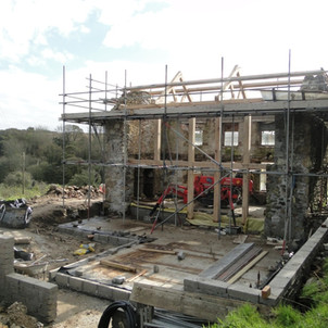 Structural oak frame to replace rear wall of Cornish cottage