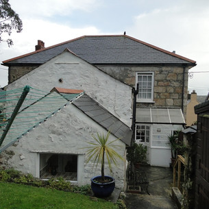 Original rear entrance and patio before works commenced.